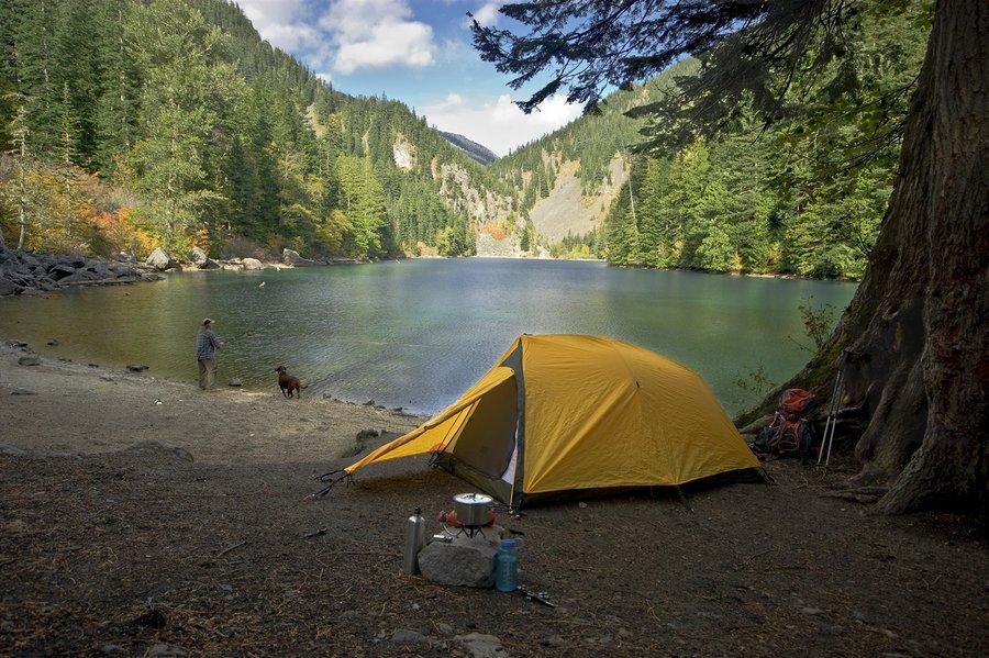Fisherman Tent Camping At A Wilderness Lake