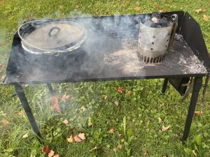 Apple cobbler in a dutch oven with dutch oven table